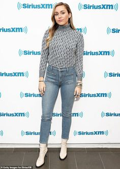 61951ee7 Miley Cyrus covers up her figure in a conservative turtleneck and jeans |  Daily Mail Online