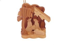$9.20-$8.95 Small Nativity. This exclusive 3-D ornament is hand carved in Bethlehem, the Holy Land. A scroll saw is used to carve this intricate design. The rich color and interesting veins are characteristic of the beautiful Bethlehem Olive Wood. This ornament comes ready to hang complete with a golden string and an explanation card (describing the workmanship). Add a beautiful décor to your Ch ...