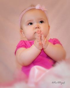 Baby praying. Cutie:) I pray every night, & if my baby girl is up, she will start singing. Hehe My favorite part of the night <3