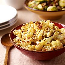 Preheat oven to 450ºF.        In a large bowl, combine cauliflower, oil, salt and pepper; toss to combine. Transfer cauliflower to a large baking sheet and spread into a single layer. Roast until cauliflower is golden brown, tossing occasionally, about 15 minutes. Remove from oven, place in serving bowl and sprinkle with cheese; toss to mix. Yields about 3/4 cup per serving.