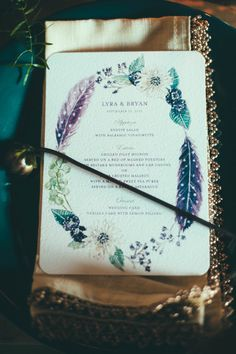 feather wedding invitations, photo by Off Beet Productions http://ruffledblog.com/bohemian-nouveau-styled-wedding #weddinginvitations #stationery  Visit our website at www.firethorne.org! #wedding #design #rsvp #invitation #savethedate