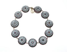 """Concentric circles of Swarovski Crystals in Amethyst and Turquoise all linked together with love.17.5"""""""