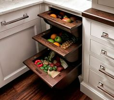 Kitchen pull-outs are a dreamy feature of custom kitchens, making access to things like trash, recycling, and pantry essentials much easier. Here's a new twist on the pull-out theme: Basket drawers for root vegetables and fruit.