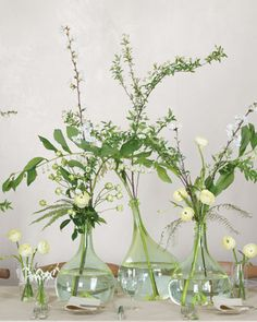 Solomon's seal, spiraea branches, ferns, Japanese spray roses, ranunculus, and apple blossoms.