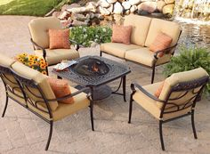 Extend the season with seating around a cozy firepit coffee table from the BHG Paxton Place Collection