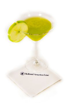 Big Game #Cocktail - The Hawkeye: Combine 1.0 oz. vodka, 1.0 oz. apple pucker and 1.0 oz. house sour in a shaker filled with ice. Shake and pour into chilled martini glass. Garnish with a slice of green apple.