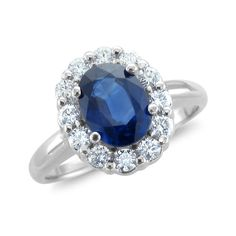 Diana Diamond and Sapphire Ring in Platinum 2.05 cttw, 8x6mm. This sapphire ring is inspired by Diana ring and Kate Middleton Ring. Has a 8x6mm oval blue sapphire set in platinum halo ring. This sapphire engagement ring with a matching diamond wedding ring will be a perfect bridal set.