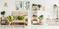 Globe shaped lamp placed on wooden table standing next to green couch in stylish living room interior Scandinavian Interior Design, Scandinavian Living, Buying Your First Home, Home Buying, Living Room Interior, Living Room Decor, Decor Room, Buffet Design, Furniture Removal