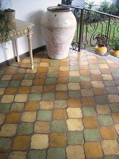 this terra cotta arabesque tile in earthy tones delivers plenty of understated elegance