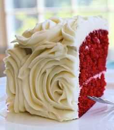 Red Velvet Cake decorated with beautiful frosting roses. Looks delicious. Red velvet cake recipe from bakerella and frosting from all recipes. Click on the picture and it will lead you to the recipe and a video tutorial for piping the roses (using a 1M star tip).