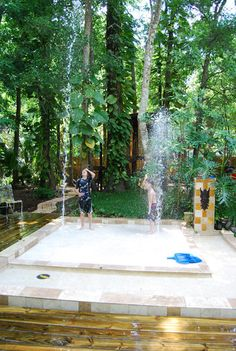 """A back yard splash pad for our four children! It is made out of beautiful (non slippery) Travertine tiles…We wanted something that looked mature, but very child friendly and most of all FUN! It is a safer alternative to a pool. It helps our whole family cool off in this hot Florida sun!""- interesting idea"