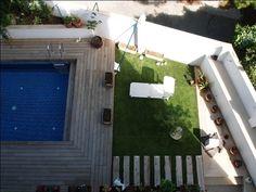 Vista jardin con piscina