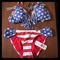 Patriotic fringe bikini Cute red, white and blue bikini! The top is labeled as an XL and the bottoms are a size S. Tags are still attached along. Would look hot for spring break! Swim Bikinis