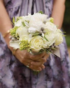 Classic blooms like peonies and roses mingle with unexpected elements, including brunia and ornithogalum, in this unusual arrangement.