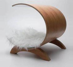 Dog Pod by Glenn Ross. Bent ply, choice of veneers, solid wood legs, faux fur pad. $729