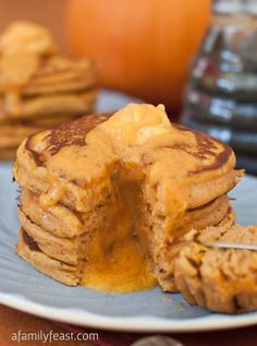 Pumpkin Pancakes with Maple Pumpkin Butter - Super fluffy and moist pumpkin pancakes and a maple pumpkin butter that is out of this world!