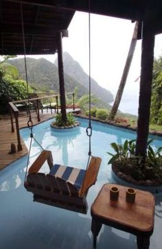 Perched high on the volcanic Caribbean island, this room at Ladera in St. Lucia has only three walls; a steep cliff above a green jungle is where the fourth wall would be. Photo: Michael Goulding, Orange County Register