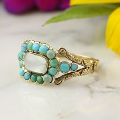 Antique Georgian Moonsone and Turquoise Halo Ring in 14k Yellow Gold by HoardJewelry on Etsy https://www.etsy.com/listing/202760863/antique-georgian-moonsone-and-turquoise