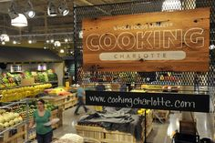 """big wooden sign for commercial kitchen- """"Cooking happens here"""""""