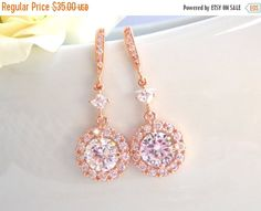Stunning Rose Gold in clear color! These beautiful cubic zirconia faceted dangle from one little stone and cubic zirconia ear wire. Absolutely