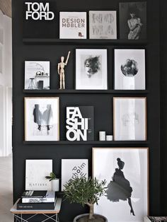 Fashion bibles a-plenty? A simple black wall and a set of shallow floating shelves is all you need. #design #wall
