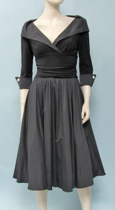 This Joseph Ribkoff black dress is very flattering, and hides a few extra pounds.  It accentuates your waist and bust and covers your arms.  The length is below knee, with a bit of a flare.  When you wear this dress, people will think you are part of the the cast of Mad Men.