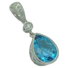 Blue Topaz Pendant with Diamond Accent https://www.goldinart.com/shop/necklaces/colored-gemstones-necklaces/blue-topaz-pendant-with-diamond-accent #14KaratWhiteGold, #BlueTopaz
