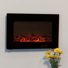 Turn down the lights and turn up the fire with the Fire Sense Black Wall Mounted Electric Fireplace . This Wall Mounted fireplace transforms any ordinary. Wall Mounted Fireplace, Fireplace Heater, Fireplace Bookshelves, Wall Mount Electric Fireplace, Cozy Fireplace, Fireplace Inserts, Fireplace Design, Electric Fireplaces, Patio Heater