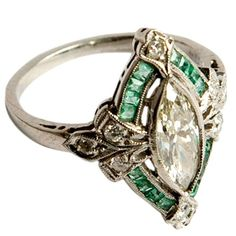 French art deco diamond and emerald ring France 1930s The marquise-cut center diamond is surrounded by diamond…