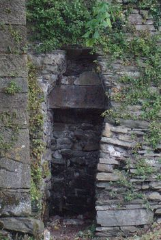 Coffin shaped hole for pauper burials, Youghal town wall - An empty coffin was once stored here for paupers who could not afford a coffin burial. Their bodies were temporarily laid in the coffin before being carried to the grave and buried in a shroud. The coffin would then be returned to await the next pauper funeral.