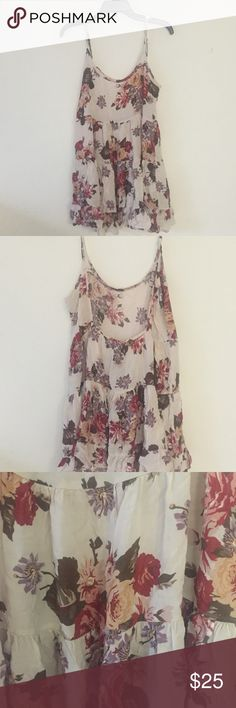 Brandy Melville Floral Open-Back Dress BRAND NEW Brandy Melville floral dress with an open back. In perfect condition, never worn. Straps are adjustable. NEW WITH TAGS! Brandy Melville Dresses