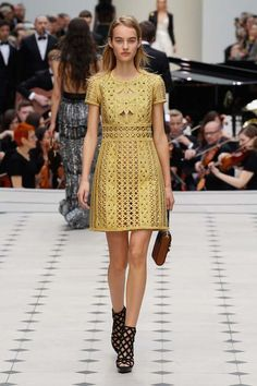 A stunning gold dress and caged heels at Burberry. #lfw