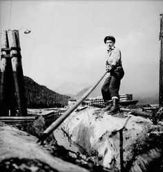 A very hardworking LumberJill uses a pike pole to move logs while working in the Queen Charlotte Islands (B.C.) in the spring of 1943.