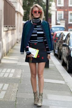 Rebecca Laurey carrying the Jimmy Choo CANDY clutch at #LFW