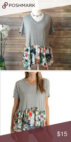 Beautiful top New without tags from Poshmark boutique @bprevite.too big for me.Beautiful grey top with floral ruffle flowy detail. Clearing out my closet. True to size. Tops