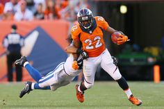 DENVER, CO - SEPTEMBER 18:  Running back C.J. Anderson #22 of the Denver Broncos shrugs off defensive back Matthias Farley #41 of the Indianapolis Colts in the second half of the game at Sports Authority Field at Mile High on September 18, 2016 in Denver, Colorado. (Photo by Justin Edmonds/Getty Images)