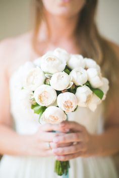 Beautiful in its simplicity: bouquet of blooming peonies.   Photography: Matthew Land Studios - www.matthewland.com  Read More: http://www.stylemepretty.com/australia-weddings/2014/07/24/diy-wedding-in-sydney-harbor/