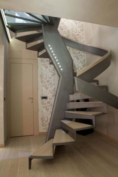 Spiral steel staircase with treads jutting out of central metal pole. Single metal handrail wraps around the stairs. Wood treads match the wood floor of the home. Timber Stair, Metal Stairs, Concrete Stairs, Modern Stairs, Painted Staircases, Painted Stairs, Interior Exterior, Interior Architecture, Open Basement Stairs