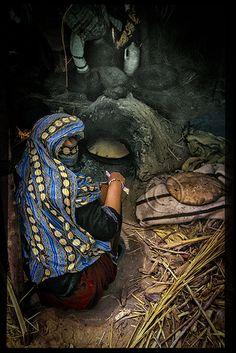 Berber Woman baking Bread. Morocco  #People of #Morocco - Maroc Désert Expérience tours http://www.marocdesertexperience.com
