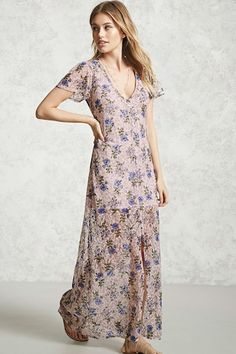 A sheer lace dress featuring an allover floral print, a V-neckline with a partial button front, short sleeves, back self-ties, a center front slit, and a partial lining.