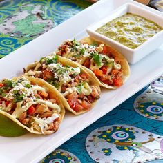 Click To Spice Up Your Night   Chicken Street Tacos   Three street style corn tortillas, green cabbage, fresh pico de gallo, roasted tomatillo salsa, Cotija cheese and avocado lime crème.