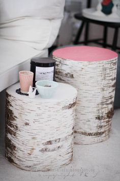 tables made from tree stumps - painted tops