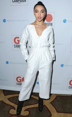 FKA Twigs in a white jumpsuit paired with black platform boots