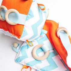 Our Baby Blue + Orange Chevron cognitive cube and sensory blanket set are the perfect toys for baby and toddler. Loaded with ribbon tags and beech wood teethers they make the perfect gift.