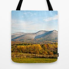 Wintery autumn Tote Bag by Pirmin Nohr - $22.00 That's a valley in October. Green grass in the front, autumnally trees down in the valley and the first snow of that year on the mountains in the background. And a big and beautiful castle ruin in the middle of the pic.   Nature, landscape, winter, snow, seasons, autumn, fall, winter, wintry,wintery, winterly, autumnally, clouds, blue, colorful, mountains