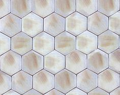 Handmade hexagon ceramic tiles in white with golden brown patches