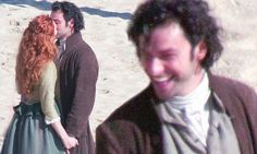 Aidan Turner and Eleanor Tomlinson were spotted sharing a tender kiss for the cameras as filming for series two of Poldark resumed on the Cornish coast.