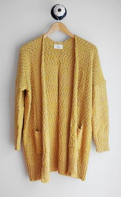 Ultra soft knitted open front cardigan with long sleeves, pockets, & beautiful mustard color. Amazingly cozy! 73% cotton, 27% acrylic Handwash cold with like colors - hang dry