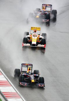 Sebastian Vettel of Germany and Red Bull Racing leads from Fernando Alonso of Spain and Renault and Mark Webber of Australia and Red Bull Racing as...