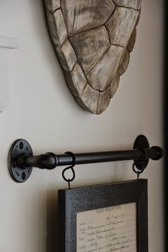 My Sweet Savannah: ~thrifty thursday~industrial pipe picture hanger Vintage Industrial Furniture, Industrial Pipe, Industrial Style, Industrial Office, Industrial Interiors, Industrial Lighting, Cadre Diy, Rustic Pictures, Pipe Decor